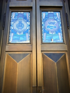 The bronze & stained glass doors