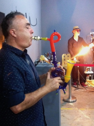 Blowing a glass instrument