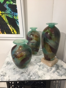 Trio, a group of painted & fired blown vessels